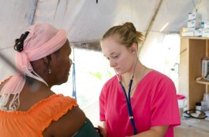 Emily Hughes, RN, takes a blood pressure reading on a patient at HHM.