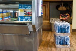 Bottles of Hays Pure Water wait for storage at the Ivy Bake Shoppe & Café