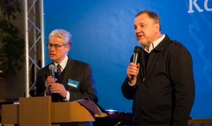 Mission Ukraine consultants Blair Carlson (left) and Anatole Glukhovskyy speak at Mission Ukraine's kickoff.